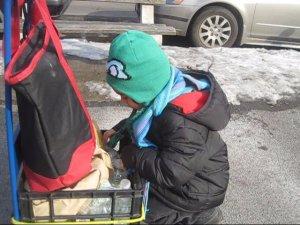 Ollie volunteers- distributes the waters.