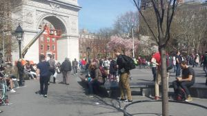 Washington Square Park was vibrant with people.