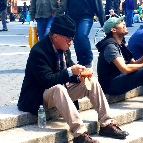 A gentleman enjoys our vegan chili. Photo by Hilda Candelario