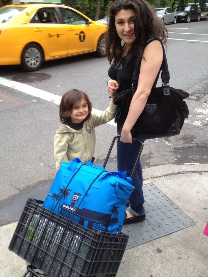 Julianna and Ollie with one of the carts, crossing the street into Tompkins Sq. Park